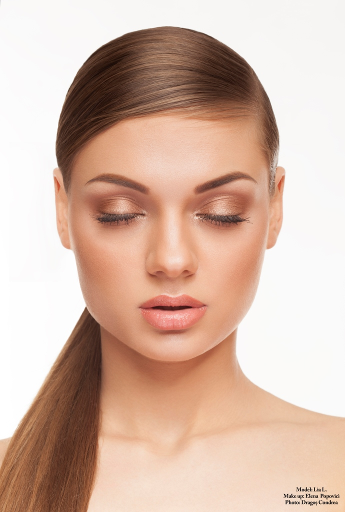 Woman with perfect skin and nude make up with closed eyes